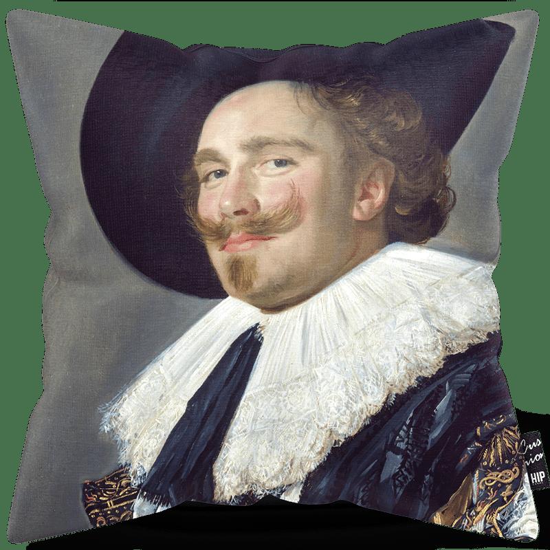 Kussen met de lachende Cavalier erop.